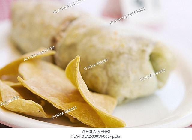Close-up of burrito and chips