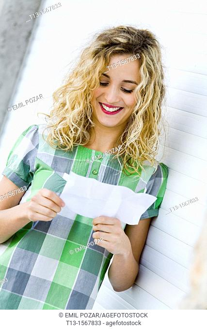 Reading paper note student girl