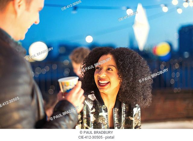 Young woman enjoying rooftop party
