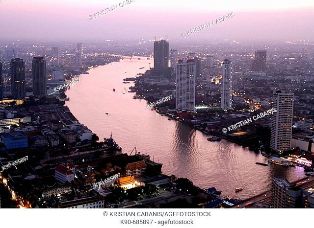 Residential buildings close to the Chao Phraya River in downtown Bangkok, the City of Angels, at dusk, Thailand, Southeast Asia