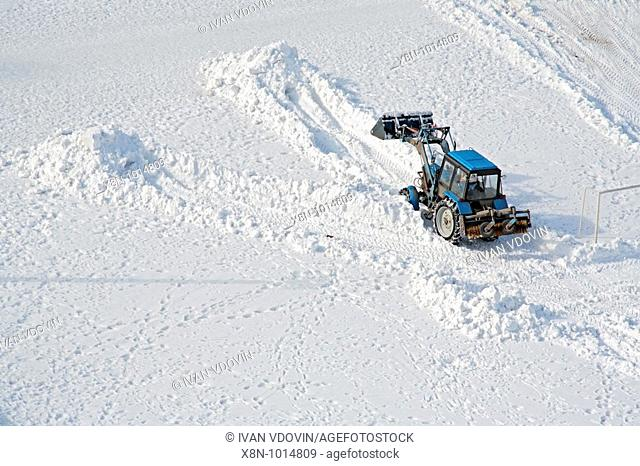 Earthmover clean snow at winter