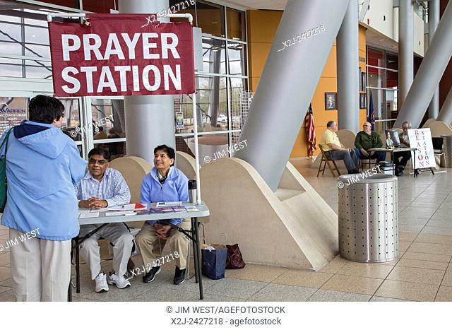 """Warren, Michigan - Christian activists operate a """"""""prayer station"""""""" in the lobby of city hall. A few steps away, atheists staff a """"""""reason station"""