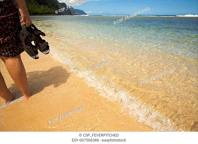 8b869f095 Canvas shoes on beach Stock Photos and Images