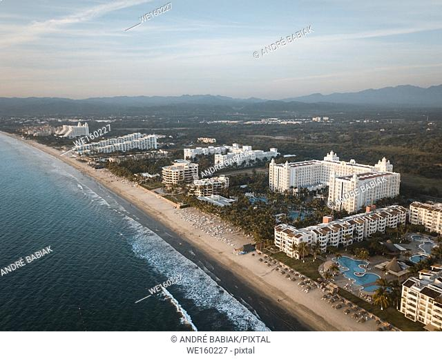 Early morning aerial view at stretch of beach with hotels at Nuevo Vallarta, Riviera Nayarit, Mexico