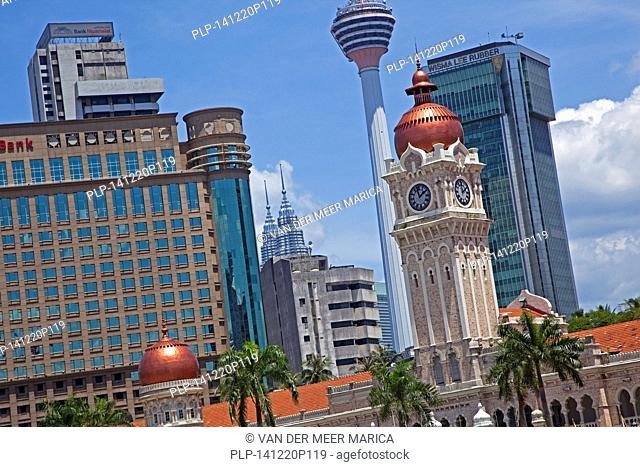 Merdeka Square showing Clock Tower of the Sultan Abdul Samad Building, Petronas twin towers and Menara tower in the city Kuala Lumpur, Malaysia