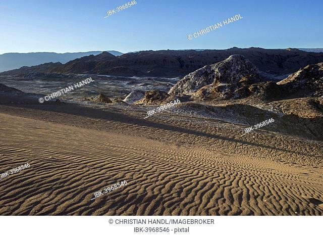 Sand dune in the Valle de la Luna or Valley of the Moon in the evening light, San Pedro de Atacama, Antofagasta Region, Chile