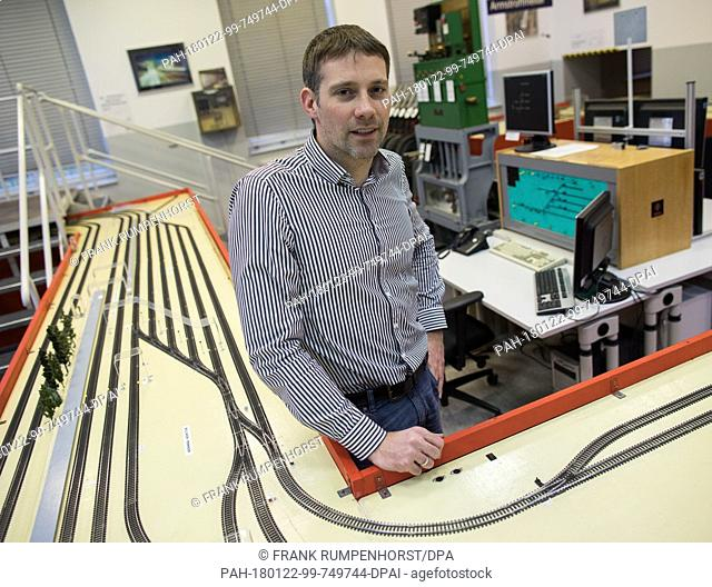 Christoph Krauß, department manager at the Fraunhofer Institute, stands in the railway company of Darmstadt, Germany, 1 December 2017