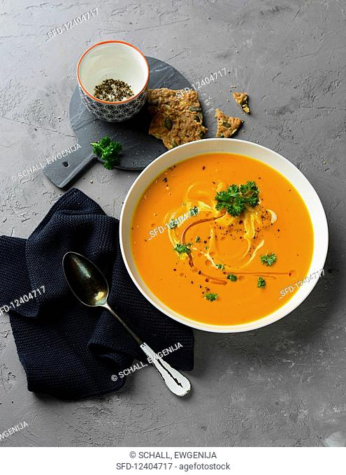 pumpkin soup sprinkled with parsley