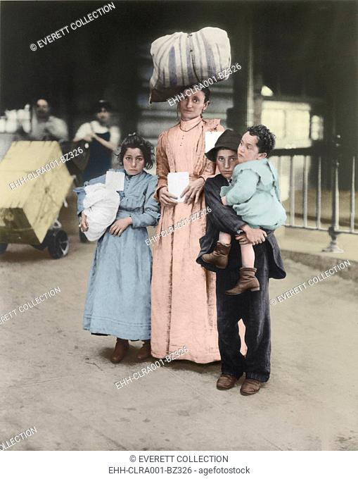 Italian immigrant family at Ellis Island, ca. 1910. The mother with three young children was probably traveling to join her husband
