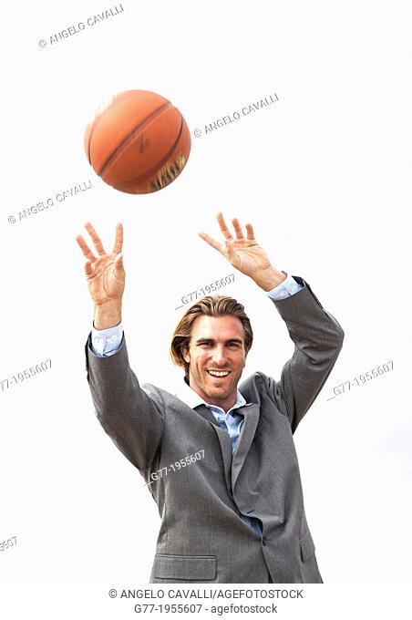 Businessman with basketball. New York, USA