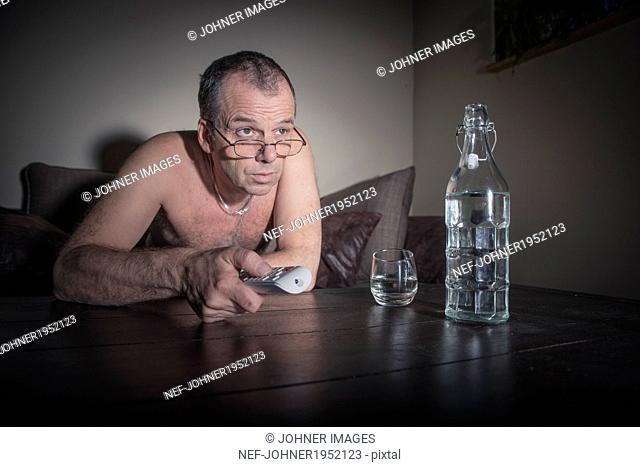 Mature man watching TV