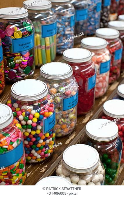 Rows of candy jars in a candy store