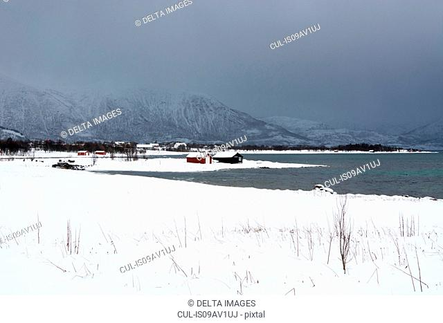 Storm clouds over snow cappedmountains, Osvoll, Lofoten and Vesteralen Islands, Norway