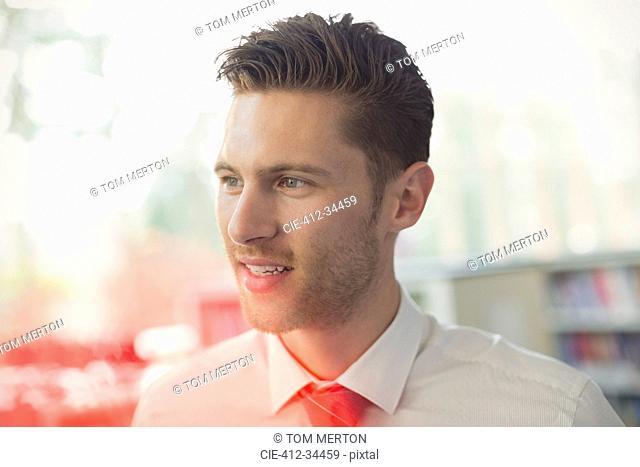 Close up brunette businessman looking away