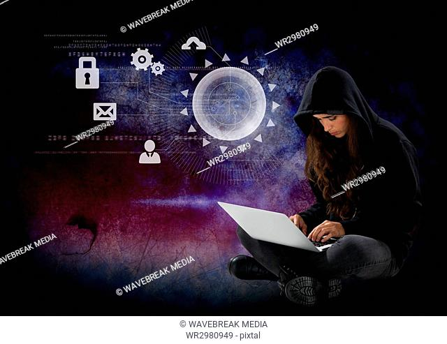 Woman hacker using a laptop in front of 3d digital background