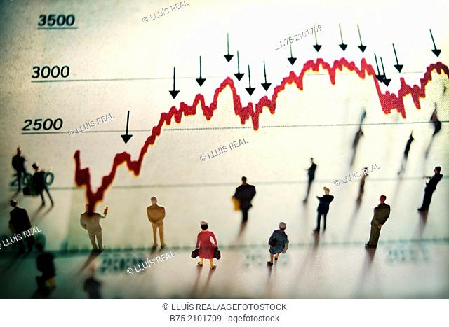 Figures of people watching an economic graph