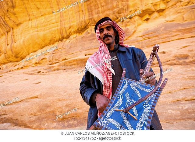 Bedouin playing a musical instrument Al Rababah, Wadi Rum, Jordan, Middle East