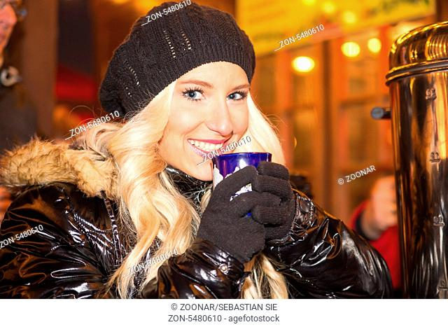 Young Blonde with mulled wine