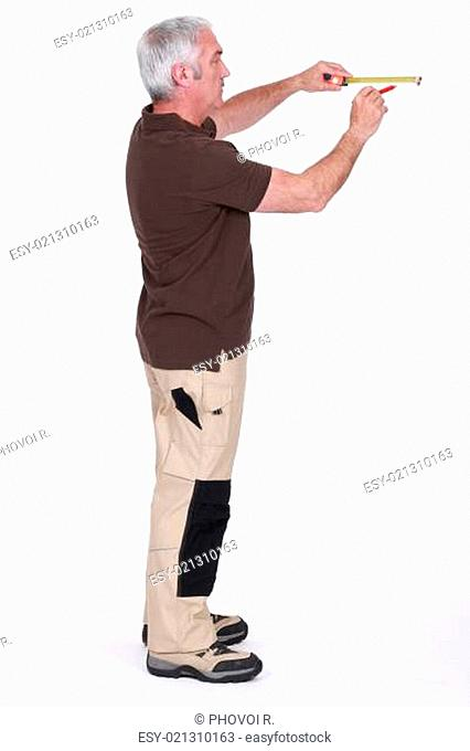 Man drawing line on wall