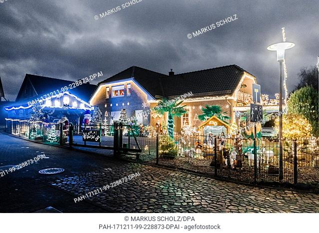 The house of the Rahlfs family shines in the night with hundreds of lights and Christmas figures in Barnitz, Germany, 5 December 2017