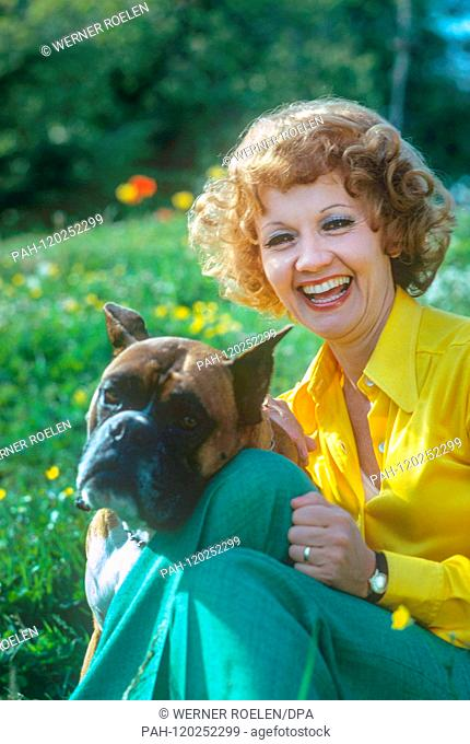 Lilo Pulver with dog in the garden of her house near Lausanne in the 1970s. Swiss actress Lilo Pulver was born on 11 October 1929 in Bern