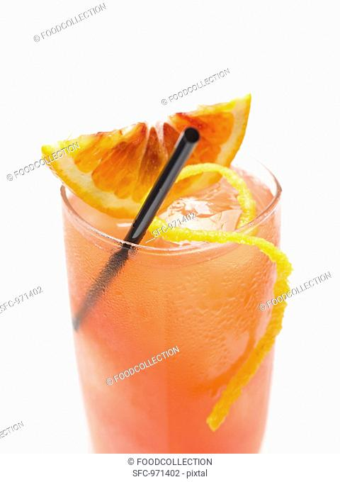 Blood orange drink with ice cubes