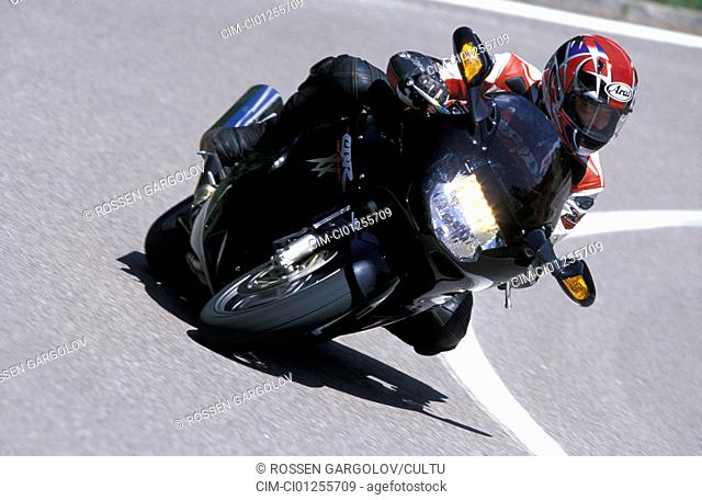 Sports motor cycle, Sporttourer, Honda CBR 1100 XX Super Blackbird, black, model year 2003, driving, inclined position, Side position, diagonal from the front