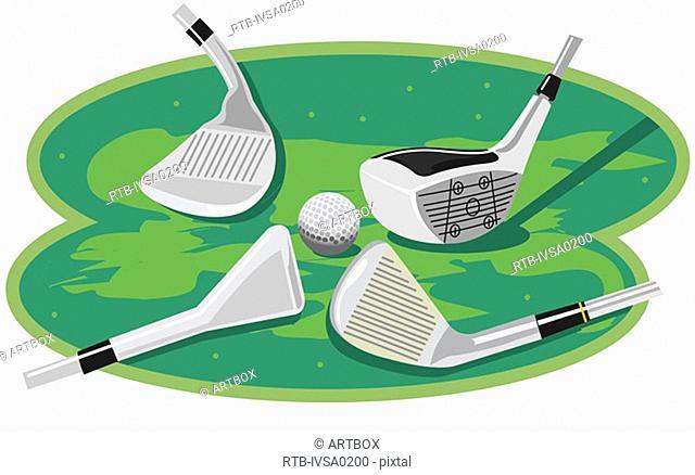 Four golf clubs near a golf ball