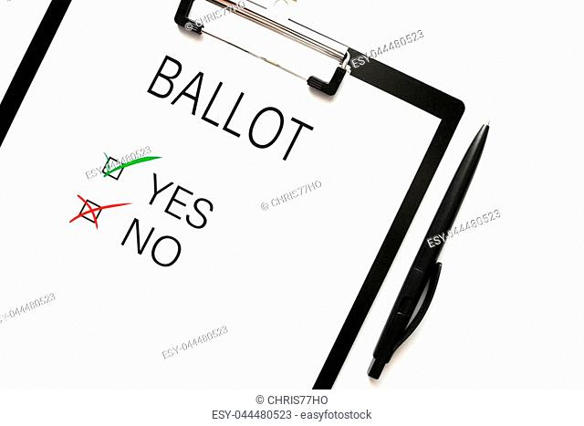 top view of ballot with choice yes or no on clipboard against white background