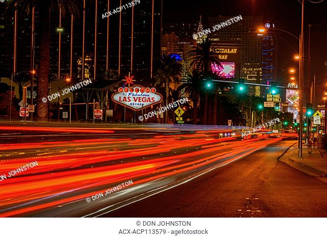 The Las Vegas welcome sign at night with traffic on Las Vegas Blvd, Las Vegas, Nevada, USA