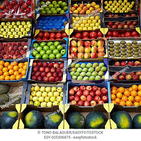 Fruits background in boxes display at market in spain