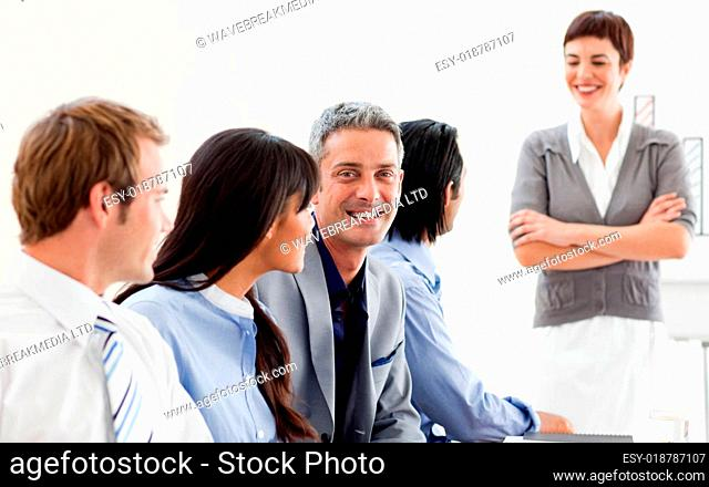 Glowing businesswoman presenting to her team