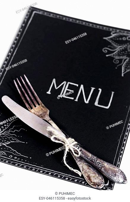 Cafe menu restaurant on the black sheet with white background and beautiful Cutlery