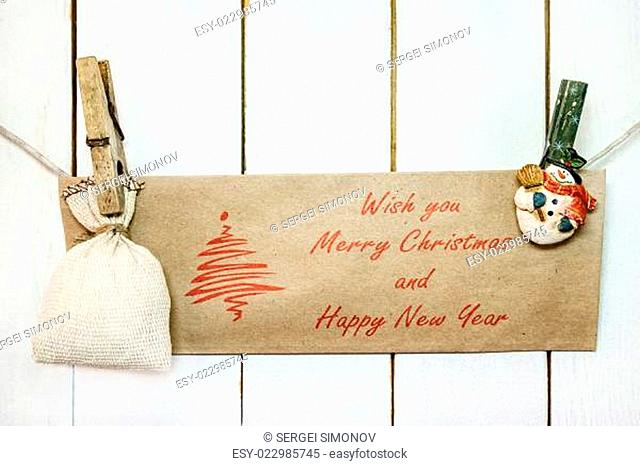 Christmas snowman clothespines holding Christmas greeting card