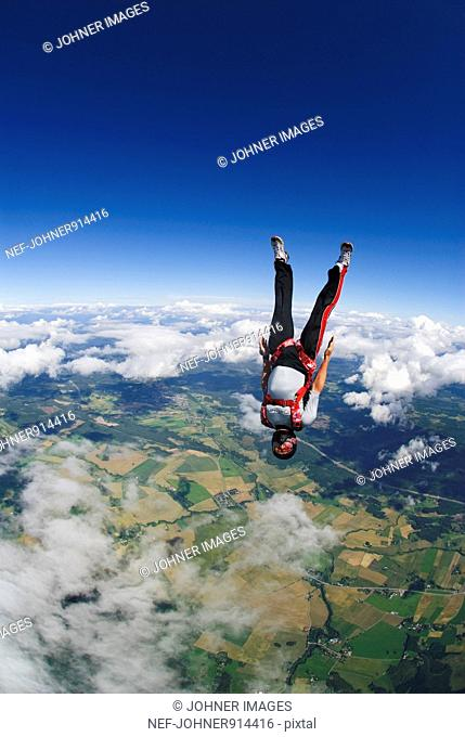 Scandinavia, Sweden, Uppland, Skydiver flying mid-air