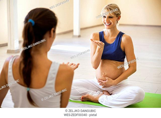 Prenatal yoga, female yoga instructor, breating, laughing