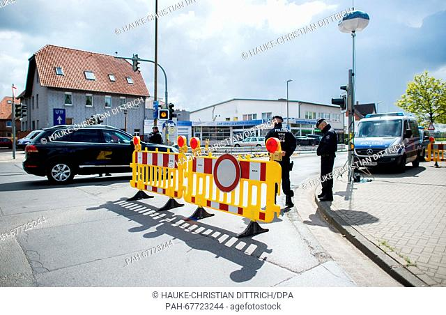 Members of the German police check cars in front of the security perimeter surrounding the Seefugium Hotel ahead of the visit of USPresident Obama, in Hanover