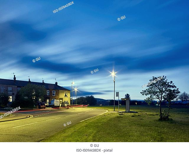 Light trails on road at night in residential area