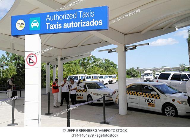Mexico, Yucatán Peninsula, Quintana Roo, Cancun, Cancun International Airport, Hispanic, man, taxi, ground transportation, sign, bilingual, Spanish language