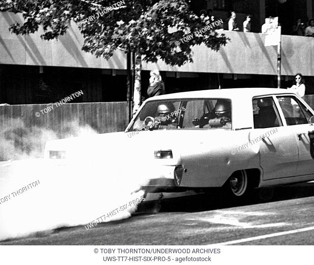 Berkeley, California: May, 1969 A Berkeley police car releases pepper gas from its trunk on Telegraph Avenue on the first day of confrontations in the People's...