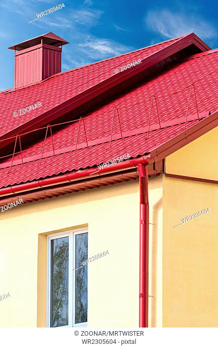 house with new red metal roof