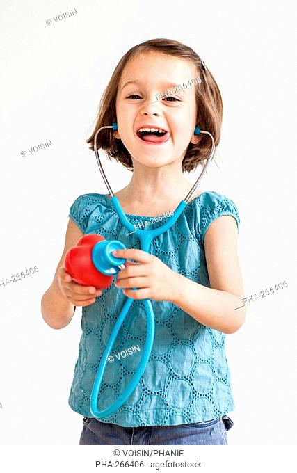 5 year old girl playing with a toy stethoscope