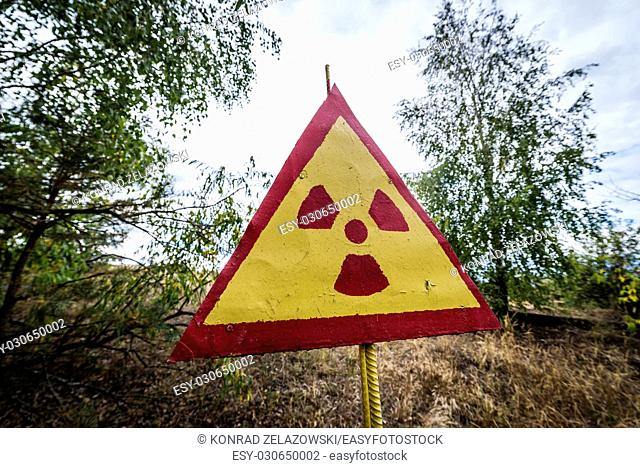 Ionising radiation warning sign on a cemetery in Pripyat ghost city of Chernobyl Nuclear Power Plant Zone of Alienation in Ukraine