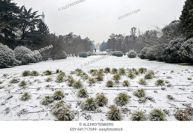Parco Sempione in Milan, Lombardy, Italy covered in snow. Arco Della Pace, translated to Peace Arch, in the far background
