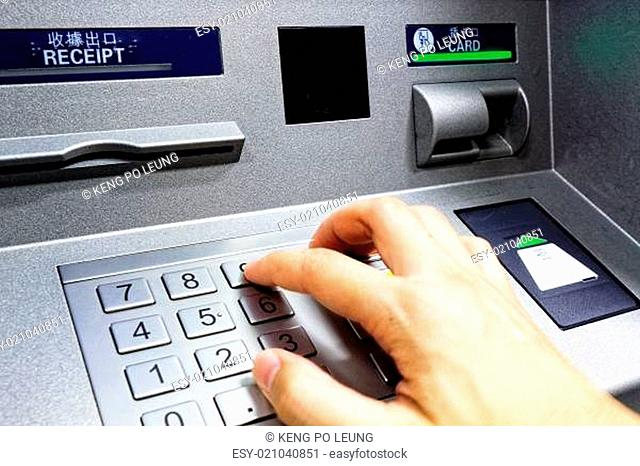 ATM - entering pin close up