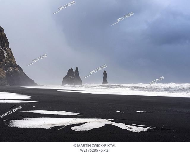 The coast of the north atlantic near Vik y Myrdal during winter. Black volcanic beach Reynisfjara with the sea stacks Reynisdrangar