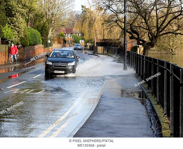 UK, Surrey, Cobham, flood water on road splash