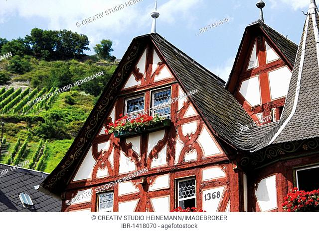 Old half-timbered house in the old town of Bacharach in front of a vineyard, Unesco World Heritage, Mittelrheintal valley, Rhineland-Palatinate, Germany, Europe