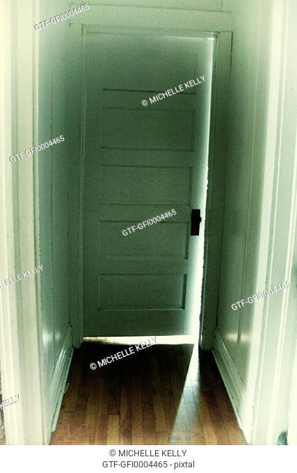 door way with light shining through cracks