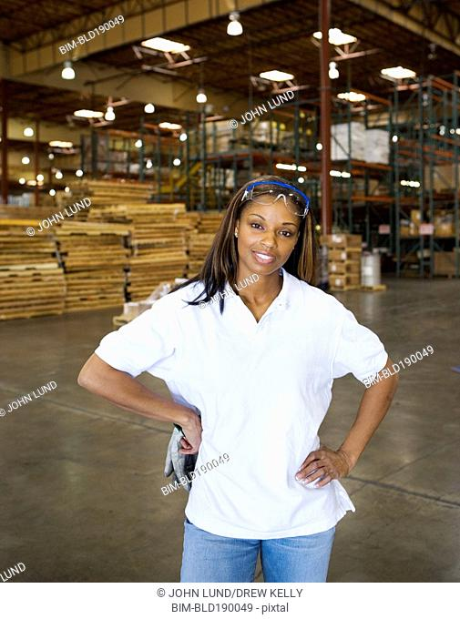 African female warehouse worker smiling